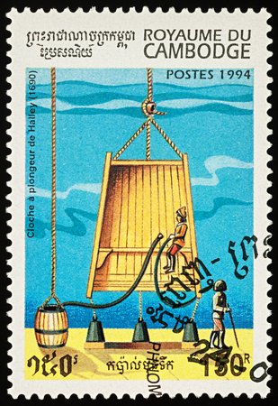 Moscow, Russia - November 19, 2017: A stamp printed in Cambodia shows old diving bell of Edmond Halley (1690), series Submarines, circa 1994