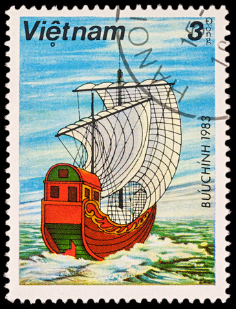 Moscow, Russia - November 21, 2017: A stamp printed in Vietnam shows old Asian sailing ship - junk with white sails, series Boats, circa 1983