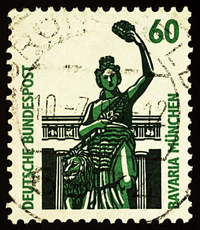 Moscow, Russia - December 02, 2017: A stamp printed in Germany shows allegorical statue of Bavaria in front of the Hall of Fame in Munich (built in 1850), series