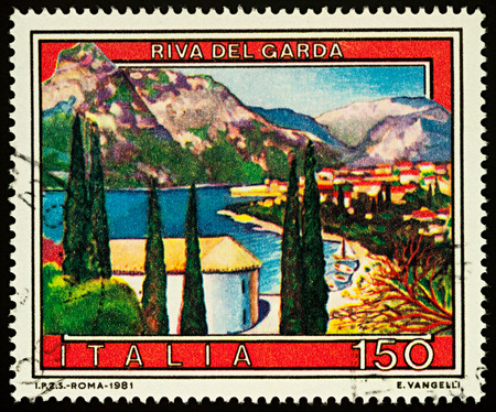 Moscow, Russia - December 03, 2017: A stamp printed in Italy shows town of Riva del Garda in northern Italy, series Tourist Attractions, circa 1981