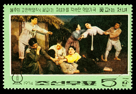 Moscow, Russia - December 30, 2017: A stamp printed in DPRK (North Korea) shows scene Death of Kkot Puns Mother from Korean Revolutionary opera The Flower Girl, circa 1974