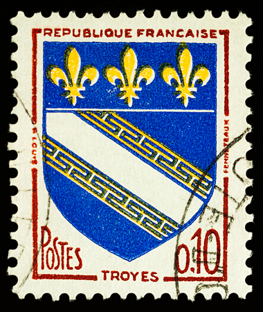 Moscow, Russia - December 27, 2017: A stamp printed in France, shows coat of arms of Troyes, the capital of the Aube department in north-central France, circa 1963