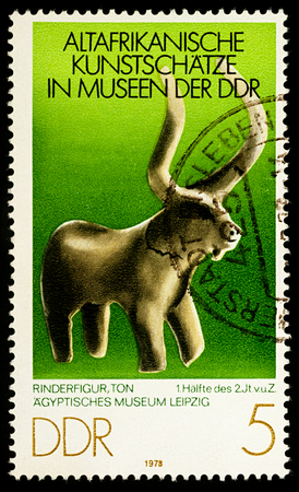 Moscow, Russia - December 30, 2017: A stamp printed in GDR (East Germany), shows ancient bull figure from Egyptian Museum of Leipzig, series Old African Art Treasures, circa 1978 Editorial