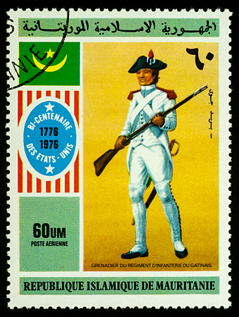 Moscow, Russia - January 04, 2018: A stamp printed in Mauritania, shows Grenadier of the Gatinais Infantry Regiment, series Bicentenary of the Independence of the United States, circa 1976