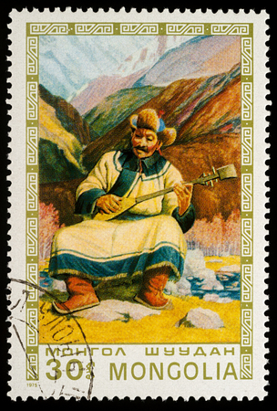 Moscow, Russia - January 06, 2018: A stamp printed in Mongolia, shows Mongolian old man playing lute on mountain background, series Mongolian paintings masterfully, circa 1975