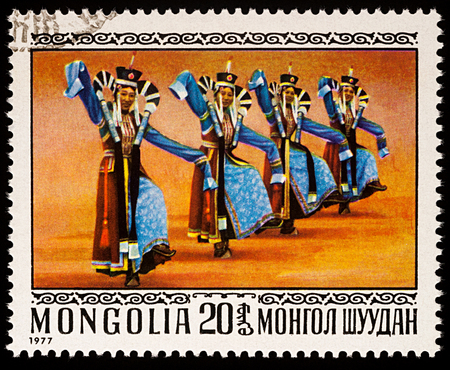 Moscow, Russia - January 08, 2018: A stamp printed in Mongolia, shows Mongolian women in 13th Century Costumes, series Folk Dances, circa 1977