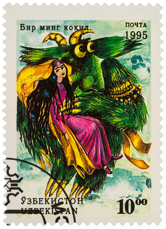 Moscow, Russia - January 15, 2018: A stamp printed in Uzbekistan shows woman and monster bird, a scene from Asian fairy tale Thousand plaits, series Folk Tales, circa 1995 Editöryel