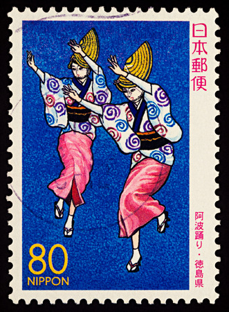 Moscow, Russia - January 31, 2018: A stamp printed in Japan shows two Japanese dancing women, Awa Odori Dancers, series Prefectural Stamps - Tokushima, circa 2000 Editorial