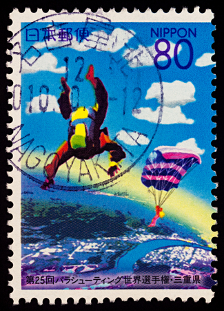 Moscow, Russia - January 31, 2018: A stamp printed in Japan shows Skydivers in the sky, dedicated to the 25th World Parachuting Championships, series Prefectural Stamps - Mie, circa 2000