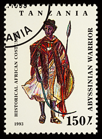 "Moscow, Russia - February 26, 2018: A stamp printed in Tanzania, shows African man in traditional clothes, Abyssinian warrior, series ""Historical African Costumes"", circa 1993"