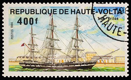 Moscow, Russia - March 01, 2018: A stamp printed in Upper Volta (Burkina Faso) shows sailing ship True Briton, series Ships, circa 1984 Sajtókép