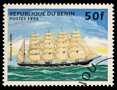 Moscow, Russia - March 06, 2018: A stamp printed in Benin shows 5-masted sailing ship (barque), series Ships, circa 1996