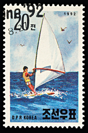 Moscow, Russia - March 03, 2018: A stamp printed in DPRK (North Korea) shows windsurfer in the sea, series