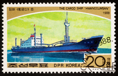 Moscow, Russia - March 11, 2018: A stamp printed in DPRK (North Korea) shows cargo ship Hwanggumsan, series Ships, circa 1988 Editorial