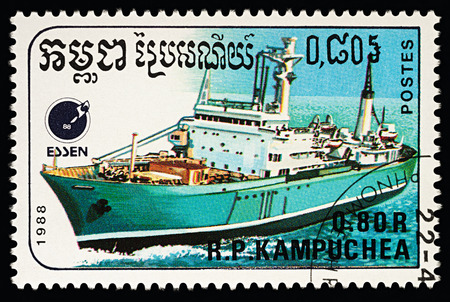 Moscow, Russia - March 13, 2018: A stamp printed in Cambodia shows cargo ship, series Ships, circa 1988