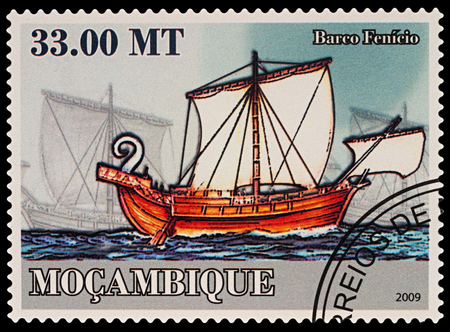 Moscow, Russia - March 14, 2018: A stamp printed in Mozambique shows ancient Phoenician sailing ship, series Transport - Ships, circa 2009