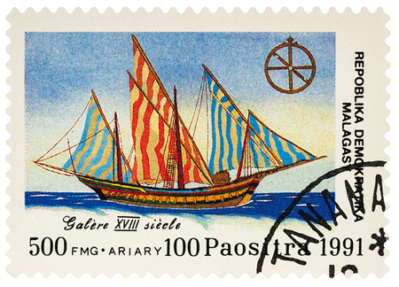 Moscow, Russia - March 17, 2018: A stamp printed in Madagascar shows sailing ship galley (XVIII century), series Discovery of America, circa 1991