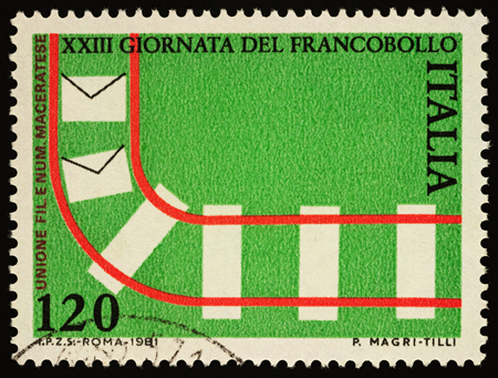 Moscow, Russia - April 05, 2018: A stamp printed in Italy shows railroad and letters, series Stamp Day, circa 1981