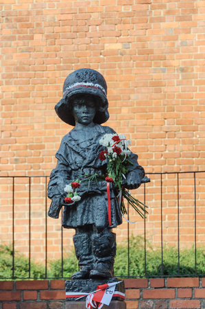 Monument to Little Rebel in Warsaw. Little boy in a helmet with a gun. Dedicated to the children who participated in Warsaw uprising of 1944. Sajtókép