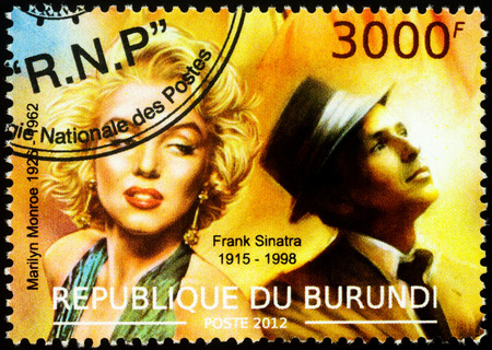Moscow, Russia - November 12, 2019: stamp printed in Burundi shows portraits of Marilyn Monroe (1926-1962) and Frank Sinatra (1915-1998) - famous American singers, circa 2012 Redakční