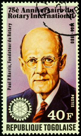 Moscow, Russia - November 08, 2019: stamp printed in Togo shows portrait of Paul Percy Harris (1868-1947), dedicated to the 75th Anniversary of Rotary International, circa 1980 Editorial