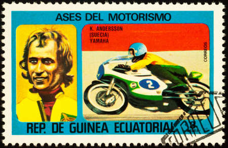 Moscow, Russia - September 14, 2020: stamp printed in Equatorial Guinea shows racing motorcyclist and portrait of Swedish motorcycle road racer Kent Andersson, series Motorcyclists, circa 1976