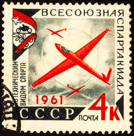 Moscow, Russia - September 17, 2020: stamp printed in USSR (Russia), shows glider plane in sky, series Spartakiada of Technical Sports, circa 1961