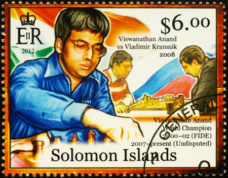 Moscow, Russia - September 19, 2020: stamp printed in Solomon Islands shows Viswanathan Anand, Indian chess player, world chess champion, series History of Chess, circa 2012
