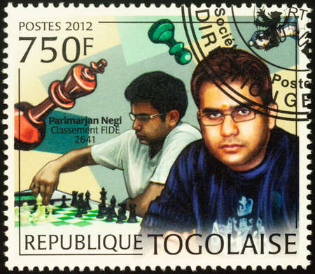 Moscow, Russia - September 18, 2020: A stamp printed in Togo shows Parimarjan Negi, young Indian chess grandmaster, series Young Chess Players, circa 2012 Editorial