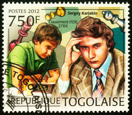 Moscow, Russia - September 18, 2020: A stamp printed in Togo shows Sergey Karyakin, Russian chess grandmaster (formerly representing Ukraine), series Young Chess Players, circa 2012