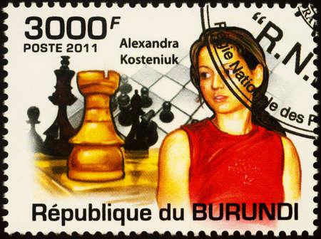 Moscow, Russia - September 20, 2020: stamp printed in Burundi shows portrait of Alexandra Kostenjuk, Russian chess player, grandmaster, twelfth world chess champion, series Chess Masters, circa 2011