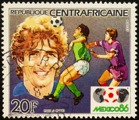 Moscow, Russia - September 21, 2020: stamp printed in Central African Republic shows portrait of famous Italian football player Paolo Rossi, series Football World Cup - Mexico 1986, circa 1985 Editorial