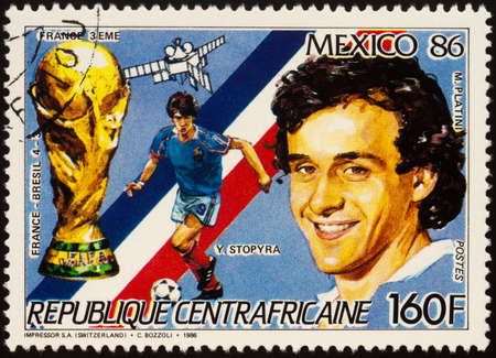 Moscow, Russia - September 22, 2020: stamp printed in Central African Republic shows French football players Michel Platini and Yannick Stopyra, series Football World Cup - Mexico 1986, circa 1986