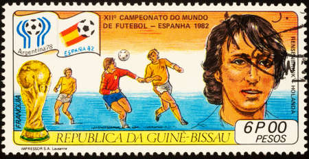 Moscow, Russia - September 22, 2020: stamp printed in Guinea-Bissau shows portrait of Dutch football player Rob Rensenbrink, series Football World Cup - Spain-82, circa 1982