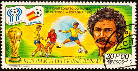 Moscow, Russia - September 22, 2020: stamp printed in Guinea-Bissau shows portrait of famous Brazilian football player Rivellino, series Football World Cup - Spain-82, circa 1982