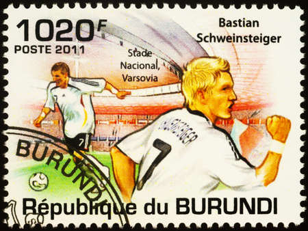 Moscow, Russia - September 23, 2020: stamp printed in Burundi shows portrait of German football player Bastian Schweinsteiger, world champion, series Personalities - Football Players, circa 2011 Editorial