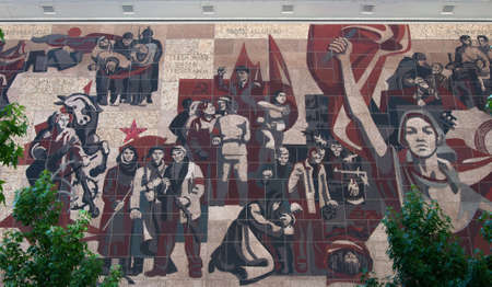 Dresden, Germany - July 26, 2019: 1960s communist propaganda, wall panel Way of the red banner (Weg der roten Fahne). German Democratic Replublic era.