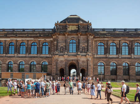 Dresden, Germany - July 26, 2019: Tourists in Zwinger, palatial complex in Dresden. Sunny summer day. Editorial