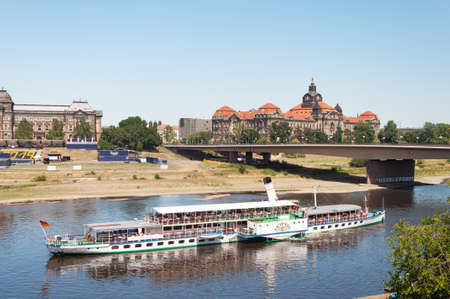 Dresden, Germany- July 26, 2019: Old paddle motor ship with tourists on Elbe river