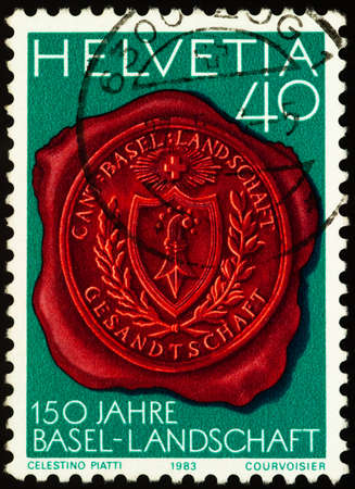Moscow, Russia - February 02, 2021: stamp printed in Switzerland shows Seal with Canton Basel coat of arms, series 150th Anniversary of Basel-Land Canton, circa 1983 Editorial