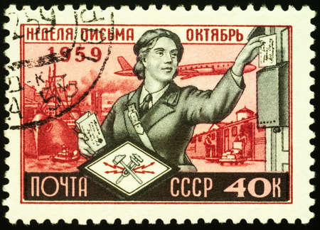 Moscow, Russia - February 05, 2021: stamp printed in USSR (Russia) shows Woman letter carrier, series International Letter Writing Week, circa 1959 Editorial