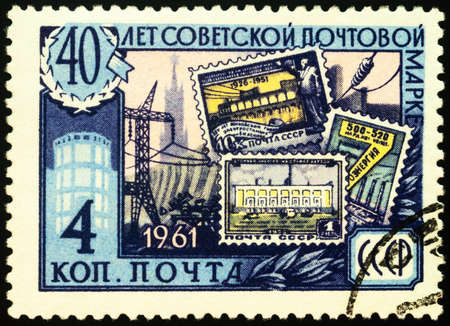 Moscow, Russia - February 04, 2021: stamp printed in USSR (Russia) shows Old Soviet postage stamps, Electrification, series The 40th Anniversary of First Soviet Stamp, circa 1961 Editorial