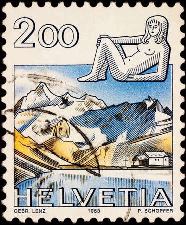 Moscow, Russia - February 21, 2021: stamp printed in Switzerland shows Image of Virgo - sign of zodiac and Aletsch glacier, Switzerland, series Zodiac signs and landscapes, circa 1983