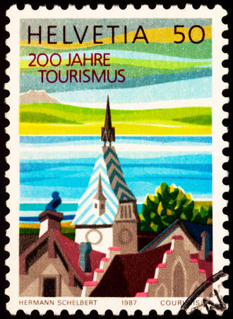 Moscow, Russia - February 23, 2021: stamp printed in Switzerland shows Zyt clock tower, Zug, dedicated to the 200th Anniversary of Tourism, circa 1987