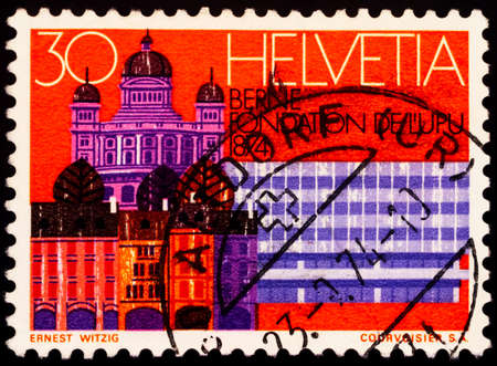 Moscow, Russia - February 19, 2021: stamp printed in Switzerland shows Bern, seat of the UPU, series Universal Postal Union Congress, Lausanne, circa 1974
