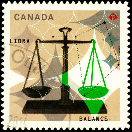 Moscow, Russia - February 22, 2021: stamp printed in Canada shows Libra (Balance), series Signs of Zodiac, circa 2012