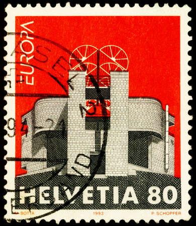 Moscow, Russia - February 23, 2021: stamp printed in Switzerland shows Single-family home in Breganzona, Lugano, Switzerland by Mario Botta, Swiss architect, series Contemporary Art, circa 1993
