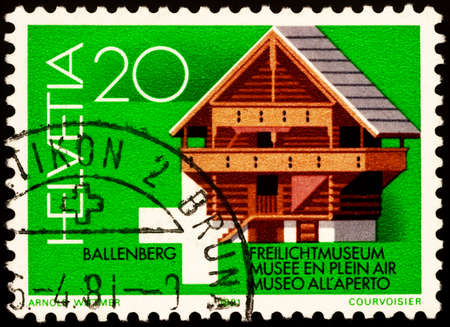 Moscow, Russia - February 22, 2021: stamp printed in Switzerland shows Old wooden storage shed of Kiesen (17th century), dedicated to the Open Air Museum, Ballenberg, circa 1981 Editorial