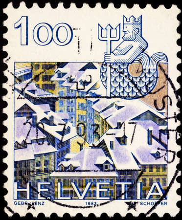 Moscow, Russia - February 21, 2021: stamp printed in Switzerland shows Image of Aquarius - sign of zodiac and old town of Bern, Switzerland, series Zodiac signs and landscapes, circa 1982