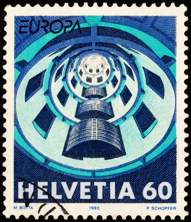 Moscow, Russia - February 24, 2021: stamp printed in Switzerland shows House of Media in Villeurbanne, by Swiss architect Mario Botta, series EUROPA Stamps - Contemporary Art, circa 1993
